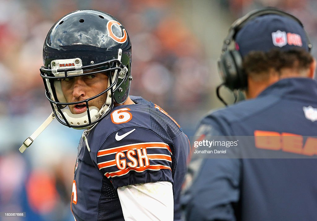 <a gi-track='captionPersonalityLinkClicked' href=/galleries/search?phrase=Jay+Cutler&family=editorial&specificpeople=622249 ng-click='$event.stopPropagation()'>Jay Cutler</a> #6 of the Chicago Bears looks back at head coach <a gi-track='captionPersonalityLinkClicked' href=/galleries/search?phrase=Marc+Trestman&family=editorial&specificpeople=2769711 ng-click='$event.stopPropagation()'>Marc Trestman</a> during a game against the New Orleans Saints at Soldier Field on October 6, 2013 in Chicago, Illinois. The Saints defeated the Bears 26-18.