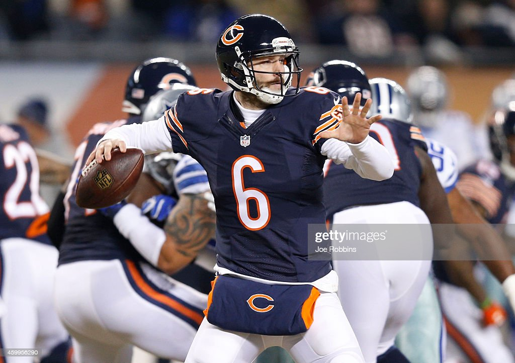 Jay Cutler #6 of the Chicago Bears passes during the first quarter of a game against the Dallas Cowboys at Soldier Field on December 4, 2014 in Chicago, Illinois.