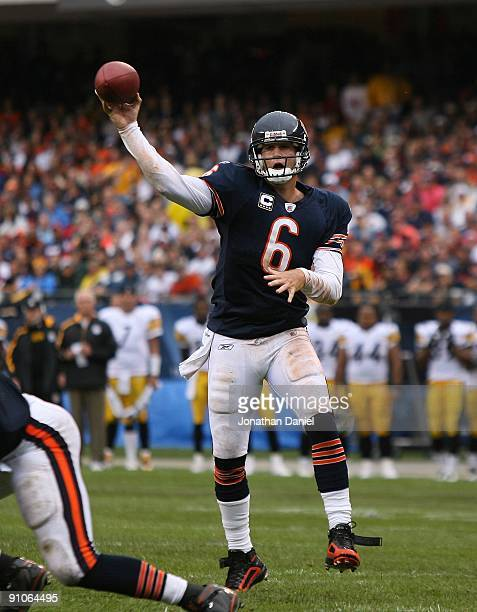 Jay Cutler of the Chicago Bears passes the ball for a touchdown against the Pittsburgh Steelers at Soldier Field on September 20 2009 in Chicago...