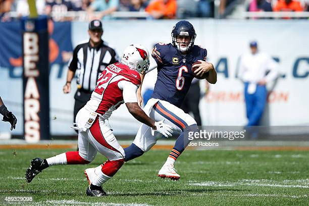 Jay Cutler of the Chicago Bears runs the ball against the Arizona Cardinals in the first quarter at Soldier Field on September 20 2015 in Chicago...