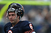 Jay Cutler of the Chicago Bears takes a break during warmups before a preseason game against the Oakland Raiders at Soldier Field on August 21 2010...