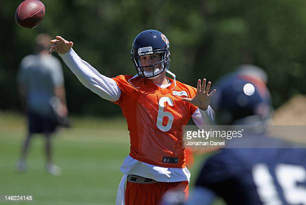 Jay Cutler of the Chicago Bears throws to Brandon Marshall during a minicamp practice at Halas Hall on June 12 2012 in Lake Forest Illinois