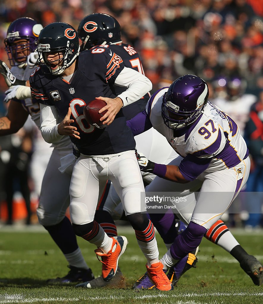 Jay Cutler #6 of the Chicago Bears tries to escape Everson Griffen #97 of the Minnesota Vikings at Soldier Field on November 25, 2012 in Chicago, Illinois. The Bears defeated the Vikings 28-10.