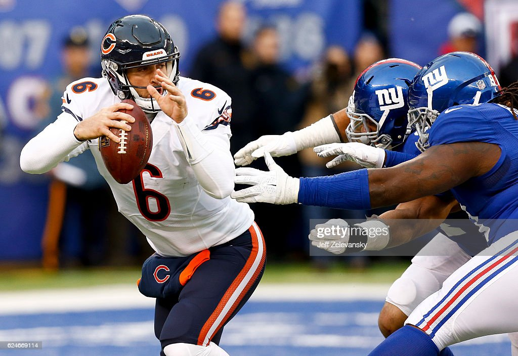 Jay Cutler #6 of the Chicago Bears tries to evade Olivier Vernon #54 and Damon Harrison #98 of the New York Giants during their game at MetLife Stadium on November 20, 2016 in East Rutherford, New Jersey.