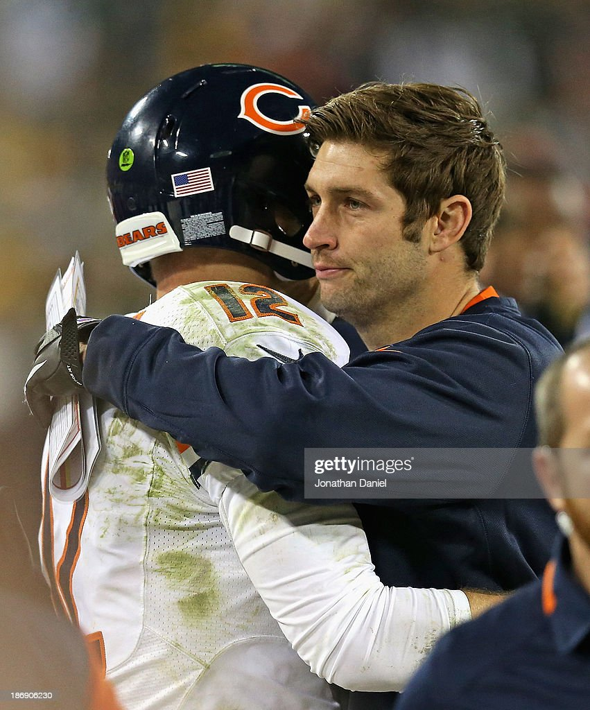 <a gi-track='captionPersonalityLinkClicked' href=/galleries/search?phrase=Jay+Cutler&family=editorial&specificpeople=622249 ng-click='$event.stopPropagation()'>Jay Cutler</a> #6 of the Chicago Bears (R), who is injured, hugs <a gi-track='captionPersonalityLinkClicked' href=/galleries/search?phrase=Josh+McCown&family=editorial&specificpeople=182518 ng-click='$event.stopPropagation()'>Josh McCown</a> #12 at the end of the game against the Green Bay Packers at Lambeau Field on November 4, 2013 in Green Bay, Wisconsin. The Bears defeated the Packers 27-20.