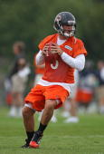 Jay Cutler of the Chicago Bears works out during a summer training camp practice at Olivet Nazarene University on July 30 2010 in Bourbonnais Illinois