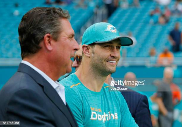 Jay Cutler right of the Miami Dolphins speaks with former Dolphins quarterback Dan Marino before the Dolphins played against the Atlanta Falcons...