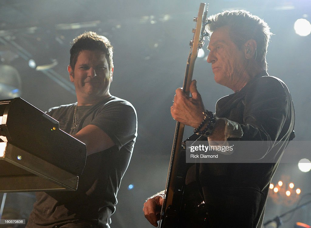 Jay DeMarcus and Ross Valory perform onstage as Journey and Rascal Flatts headline the Super Bowl XLVII CMT Crossroads Concert on February 2, 2013 in New Orleans, Louisiana.