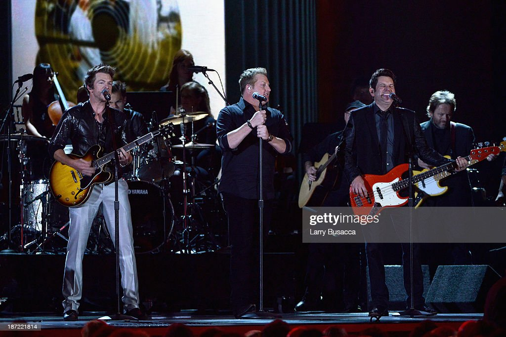 Jay DeMarcus, Gary LeVox and Joe Don Rooney of Rascal Flatts performs onstage during the 47th annual CMA awards at the Bridgestone Arena on November 6, 2013 in Nashville, United States.
