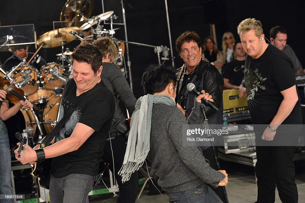 Jay DeMarcus, Joe Don Rooney, Arnel Pineda, Neal Schon and Gary LeVox perform during CMT Crossroads: Journey and Rascal Flatts Live from Super Bowl XLVII rehearsals on February 1, 2013 in New Orleans, Louisiana.