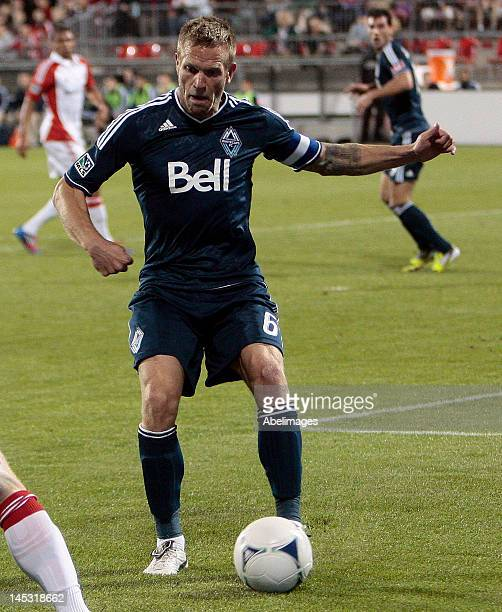 Jay DeMerit of the Vancouver Whitecaps FC battles for the ball during the Canadian Championship final second leg against Toronto FC at BMO Field May...