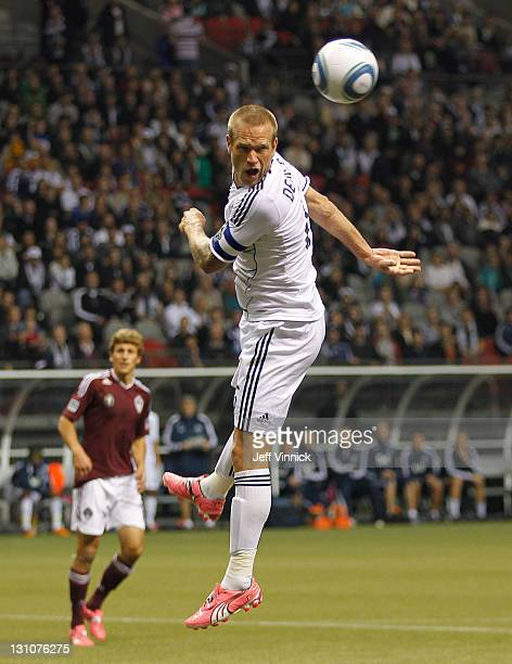 Jay DeMerit of the Vancouver Whitecaps FC heads the ball during their MLS game against the Colorado Rapids October 22 2011 at BC Place in Vancouver...