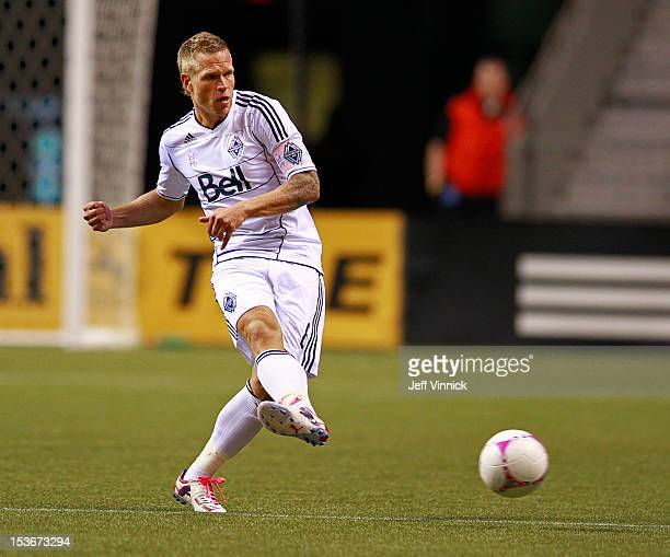 Jay DeMerit of the Vancouver Whitecaps FC kicks the ball up field during their MLS game against Chivas USA October 3 2012 at BC Place in Vancouver...