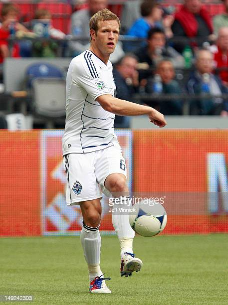 Jay DeMerit of the Vancouver Whitecaps FC passes the ball to a teammate during their MLS game against the San Jose Earthquakes July 22 2012 at BC...