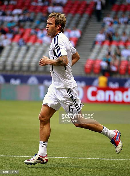 Jay DeMerit of the Vancouver Whitecaps FC runs up field during their MLS game against the Colorado Rapids September 23 2012 at BC Place in Vancouver...