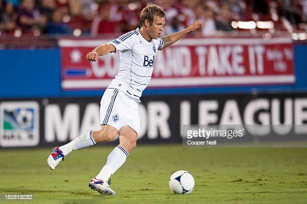 Jay DeMerit of the Vancouver Whitecaps FC takes the ball against FC Dallas on September 15 2012 at FC Dallas Stadium in Frisco Texas