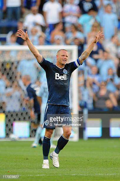 Jay DeMerit of Vancouver Whitecaps FC celebrates following a goal against the Sporting Kansas City on June 25 2011 at LiveStrong Sporting Park in...