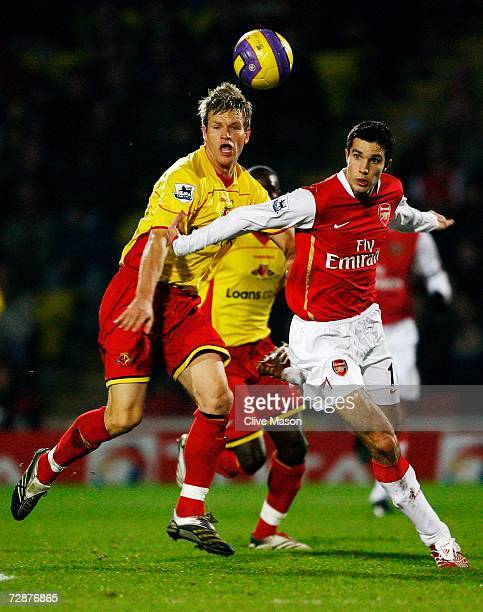 Jay Demerit of Watford and Robin van Persie of Arsenal battle for the ball during the Barclays Premiership match between Watford and Arsenal at...