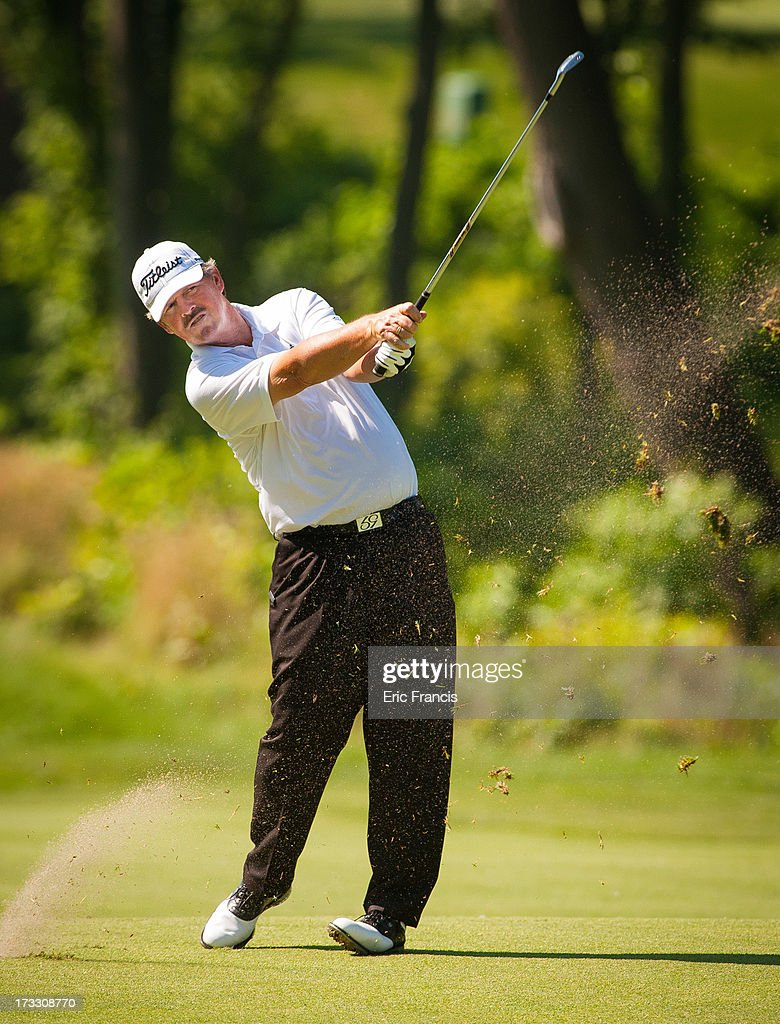 <a gi-track='captionPersonalityLinkClicked' href=/galleries/search?phrase=Jay+Don+Blake&family=editorial&specificpeople=2590968 ng-click='$event.stopPropagation()'>Jay Don Blake</a> hits an approach shot to the 17th green during the first round of the 2013 U.S. Senior Open Championship at Omaha Country Club on July 11, 2013 in Omaha, Nebraska.