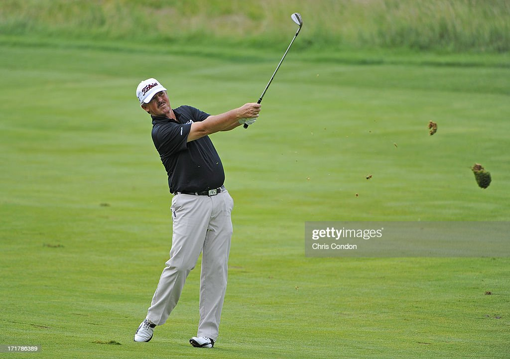 <a gi-track='captionPersonalityLinkClicked' href=/galleries/search?phrase=Jay+Don+Blake&family=editorial&specificpeople=2590968 ng-click='$event.stopPropagation()'>Jay Don Blake</a> hits from the 5th fairway during the second round of the Constellation SENIOR PLAYERS Championship at Fox Chapel Golf Club on June 28, 2013 in Pittsburgh, Pennsylvania.