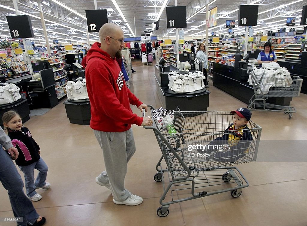Jay Ellis pushes his son, Timothy J. Ellis, 2, in a shopping cart at the new 2,000 square foot Wal-Mart Supercenter store May 17, 2006 in Bowling Green, Ohio. The new store, one of three new supercenters opening today in Ohio, employs 340 people with 60 percent of those working full-time.