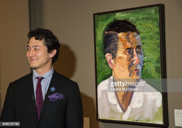 Jay Fain Jr US Army Sergeant stands in front of a painting of him painted by former US President George W Bush for the 'Portraits of Courage' exhibit...