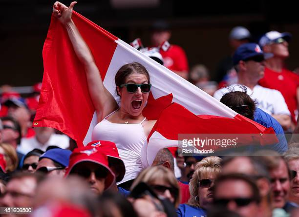 TORONTO JULY 1 A jay fan shows off her Canadian flag on Canada Day Toronto Blue Jays vs Milwaukee Brewers on July 1 Canada Day at the Rogers Centre...