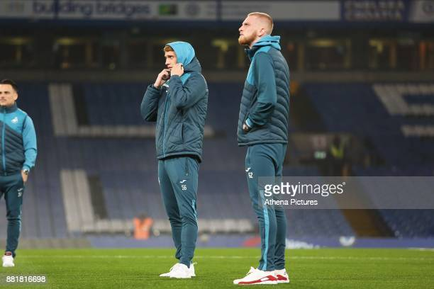 Jay Fulton and Oliver McBurnie of Swansea City prior to kick off of the Premier League match between Chelsea and Swansea City at Stamford Bridge on...