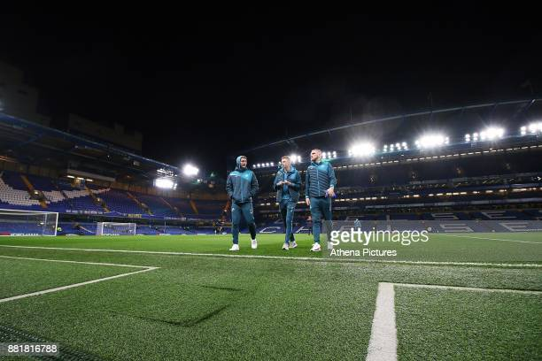 Jay Fulton and Sam Clucas of Swansea City and Oliver McBurnie prior to kick off of the Premier League match between Chelsea and Swansea City at...