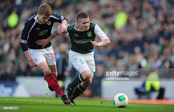 Jay Fulton of Falkirk battles with Paul Cairney of Hibernian during The William Hill Scottish Cup Semi Final between Falkirk and Hibernian at Hampden...