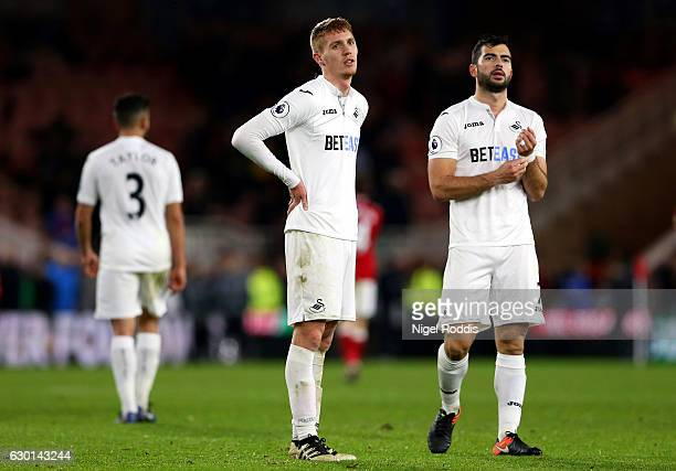 Jay Fulton of Swansea City and Jordi Amat of Swansea City look dejected after the final whistle during the Premier League match between Middlesbrough...