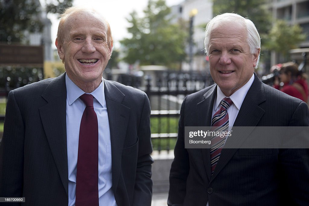 Jay Gellert, president and chief executive officer of Health Net Inc., left, and Joseph 'Joe' Swedish, chief executive officer of Wellpoint Inc., wait to go through security near the White House in Washington, D.C., U.S., on Wednesday, Oct. 23, 2013. Health insurance executives including WellPoint Inc. Chief Executive Officer Joseph Swedish will meet with top White House officials today as President Barack Obama seeks to contain political damage over the rollout of online enrollment for his health-care expansion. Photographer: Andrew Harrer/Bloomberg via Getty Images