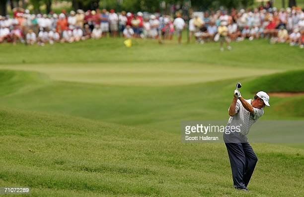Jay Haas hits his approach shot to the 16th green during the final round of the 67th Senior PGA Championship on May 28 2006 at the Oak Tree Golf Club...