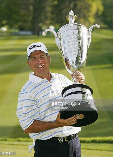 Jay Haas poses with the Alfred S Bourne trophy after winning the 69th Senior PGA Championship at Oak Hill Country Club East Course on May 25 2008 in...