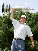 Jay Haas poses with the Bourne Trophy after defeating Brad Bryant on the third playoffhole to win the 67th Senior PGA Championship on May 28 2006 at...