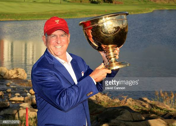 Jay Haas the United States team captain poses with the Presidents Cup after his team had won the match 155 to 145 during the Sunday singles matches...