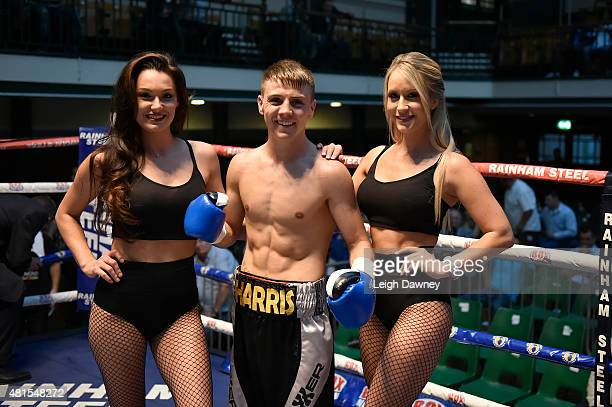 Jay Harris celebrating with ring card girls after defeating Tibor Nador in a Super Bantamweight contest at York Hall on July 17 2015 in London England