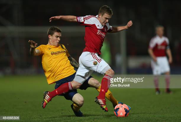 Jay Harris of Wrexham AFC attempts to move away from a challenge by Josh Ruffels of Oxford United during the FA Cup Second Round match between...