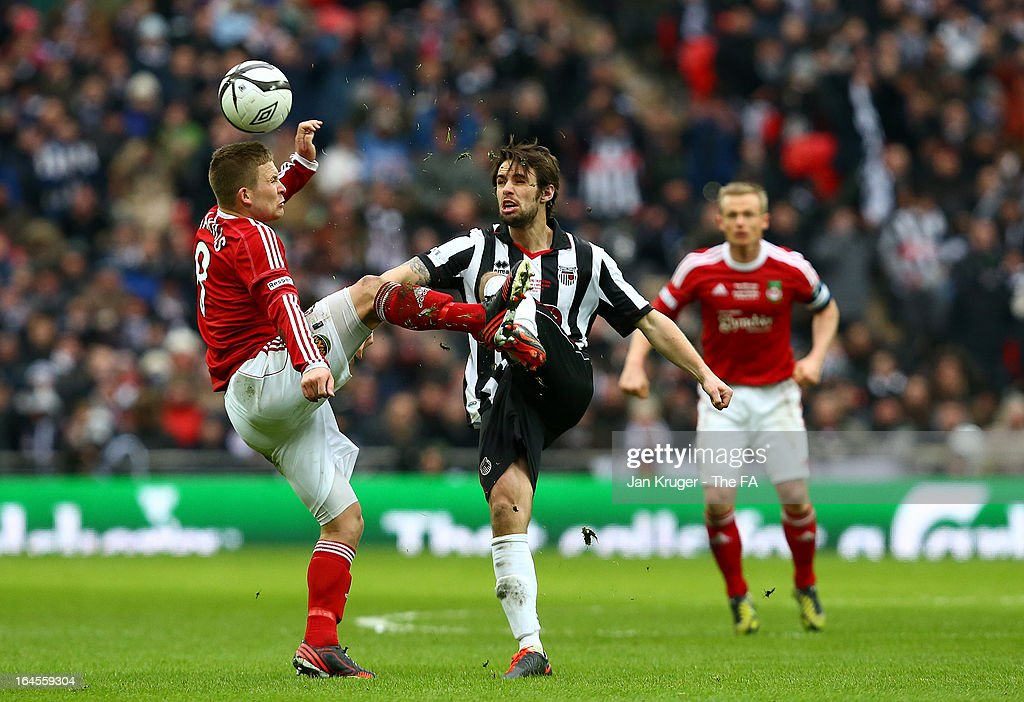 Jay Harris of Wrexham and Frankie Artus of Grimsby Town competes for the ball during the FA Trophy Final between Wrexham and Grimsby Town at Wembley Stadium on March 24, 2013 in London, England.