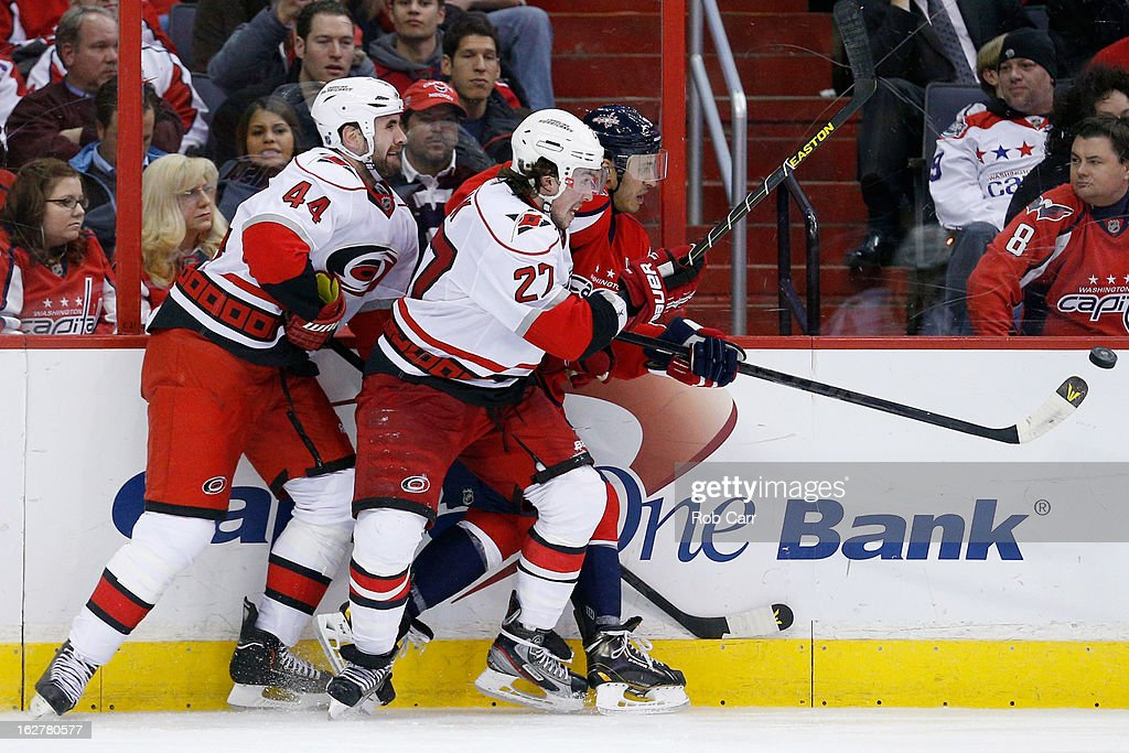 Jay Harrison #44 and Justin Faulk #27 of the Carolina Hurricanes go after the puck with <a gi-track='captionPersonalityLinkClicked' href=/galleries/search?phrase=Mike+Ribeiro&family=editorial&specificpeople=203275 ng-click='$event.stopPropagation()'>Mike Ribeiro</a> #9 of the Washington Capitals during the third period at Verizon Center on February 26, 2013 in Washington, DC.