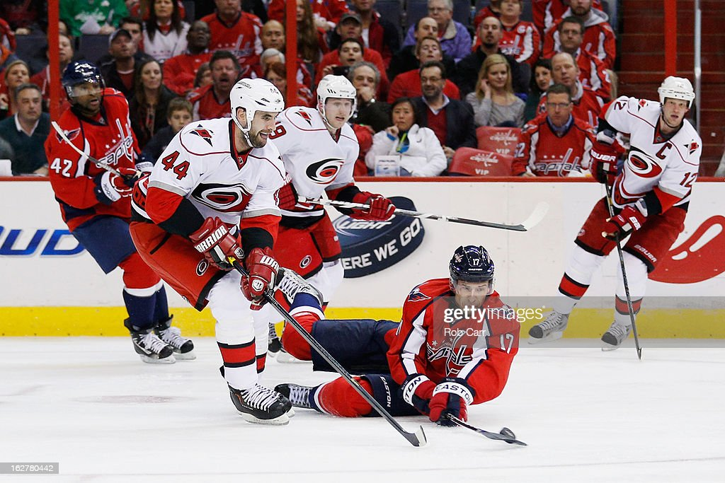 Jay Harrison #44 of the Carolina Hurricanes and <a gi-track='captionPersonalityLinkClicked' href=/galleries/search?phrase=Wojtek+Wolski&family=editorial&specificpeople=240466 ng-click='$event.stopPropagation()'>Wojtek Wolski</a> #17 of the Washington Capitals go after the puck during the third period at Verizon Center on February 26, 2013 in Washington, DC.