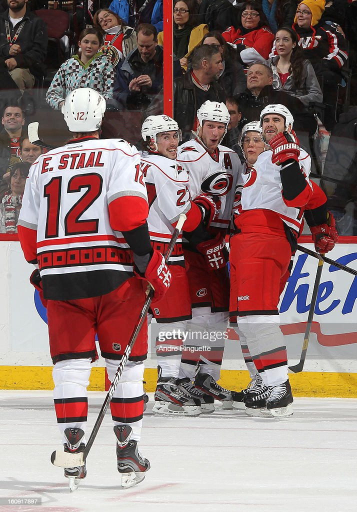 Jay Harrison #44 of the Carolina Hurricanes celebrates his game winning overtime goal against the Ottawa Senators with teammates Eric Staal #12, Justin Faulk #27, Jordan Staal #11 and Jeff Skinner #53 on February 7, 2013 at Scotiabank Place in Ottawa, Ontario, Canada.