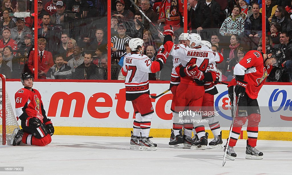 Jay Harrison #44 of the Carolina Hurricanes celebrates his game winning overtime goal against the Ottawa Senators with teammates Justin Faulk #27, <a gi-track='captionPersonalityLinkClicked' href=/galleries/search?phrase=Jordan+Staal&family=editorial&specificpeople=533044 ng-click='$event.stopPropagation()'>Jordan Staal</a> #11 and <a gi-track='captionPersonalityLinkClicked' href=/galleries/search?phrase=Jeff+Skinner&family=editorial&specificpeople=3147596 ng-click='$event.stopPropagation()'>Jeff Skinner</a> #53 as Andre Benoit #61 and Chris Phillips #4 react on February 7, 2013 at Scotiabank Place in Ottawa, Ontario, Canada.