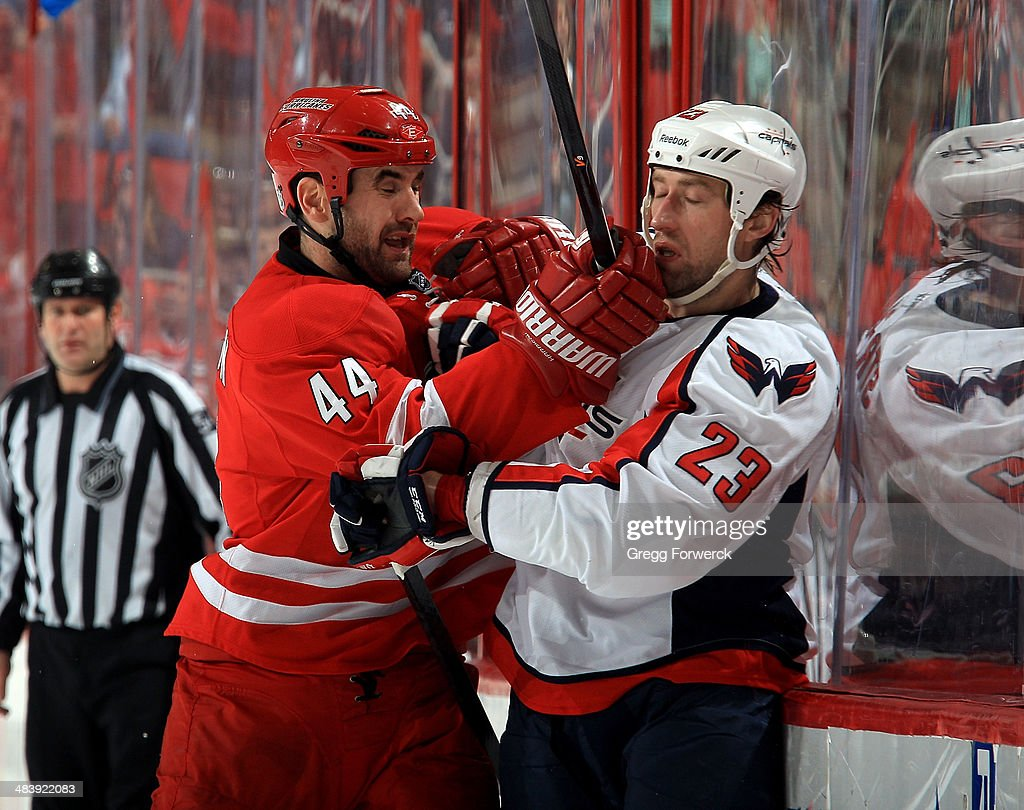 <a gi-track='captionPersonalityLinkClicked' href=/galleries/search?phrase=Jay+Harrison&family=editorial&specificpeople=714374 ng-click='$event.stopPropagation()'>Jay Harrison</a> #44 of the Carolina Hurricanes connects with <a gi-track='captionPersonalityLinkClicked' href=/galleries/search?phrase=Tyson+Strachan&family=editorial&specificpeople=5646502 ng-click='$event.stopPropagation()'>Tyson Strachan</a> #23 of the Washington Capitals during their NHL game at PNC Arena on April 10, 2014 in Raleigh, North Carolina.