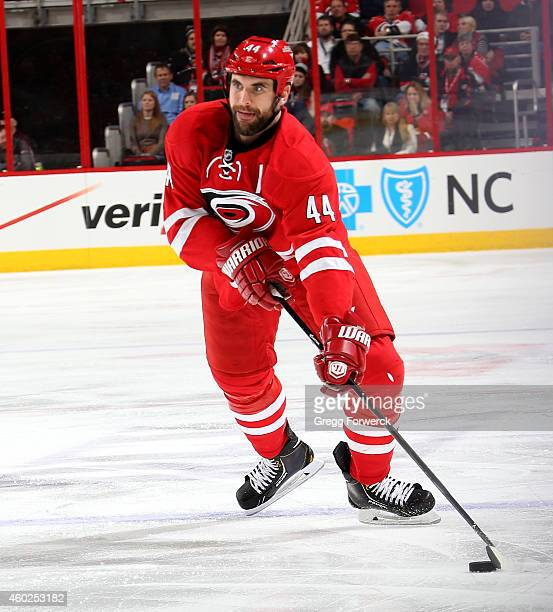 Jay Harrison of the Carolina Hurricanes controls the puck on the ice during their NHL game against the Washington Capitals at PNC Arena on December 4...