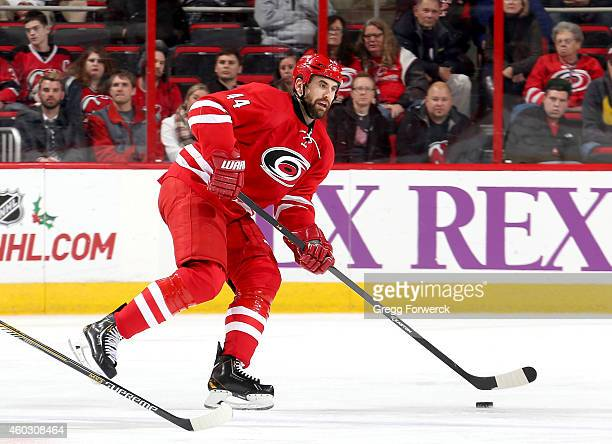 Jay Harrison of the Carolina Hurricanes controls the puck on the ice during their NHL game against the New Jersey Devils at PNC Arena on December 8...