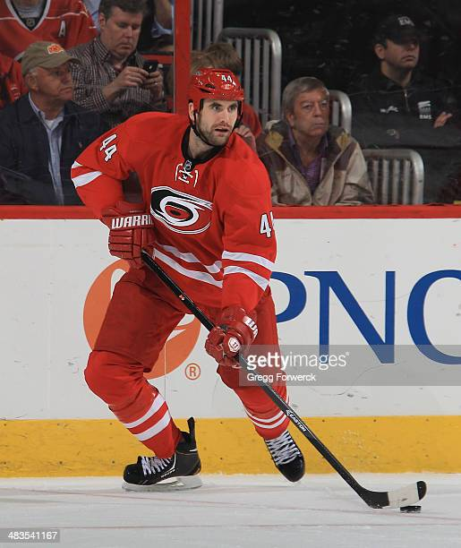Jay Harrison of the Carolina Hurricanes looks to pass the puck during their NHL game against the Dallas Stars at PNC Arena on April 3 2014 in Raleigh...