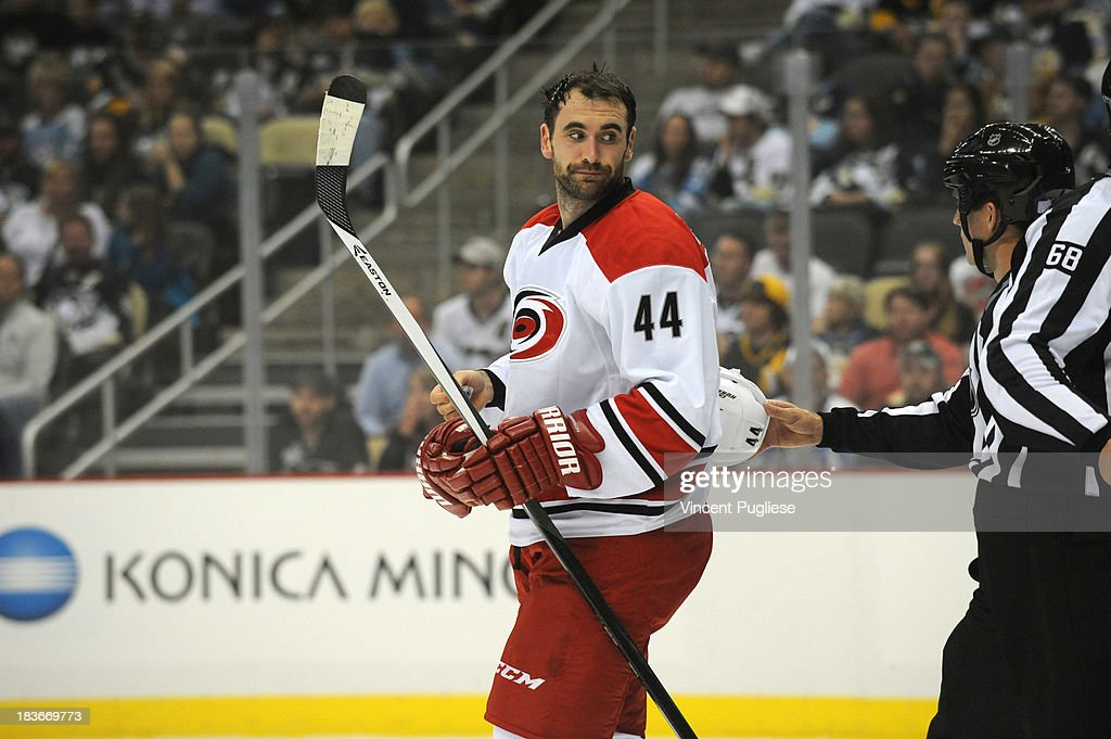 <a gi-track='captionPersonalityLinkClicked' href=/galleries/search?phrase=Jay+Harrison&family=editorial&specificpeople=714374 ng-click='$event.stopPropagation()'>Jay Harrison</a> #44 of the Carolina Hurricanes looks towards the referee after having his helmet knocked off during the first period on October 8, 2013 at the CONSOL Energy Center in Pittsburgh, Pennsylvania.