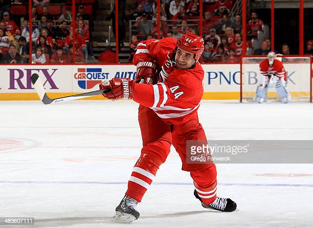 Jay Harrison of the Carolina Hurricanes shoots the puck during their NHL game against the New Jersey Devils at PNC Arena on April 5 2014 in Raleigh...