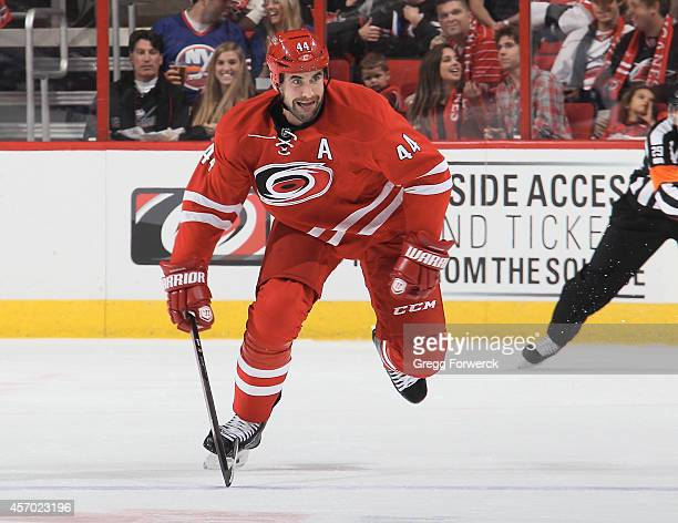 Jay Harrison of the Carolina Hurricanes skates for position on the ice during an NHL game against the New York Islanders at PNC Arena on October 10...